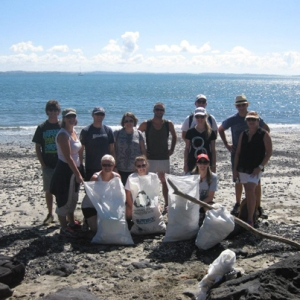 Staff from The Travel Corp NZ doing their bit to assist Sustainable Coastlines.